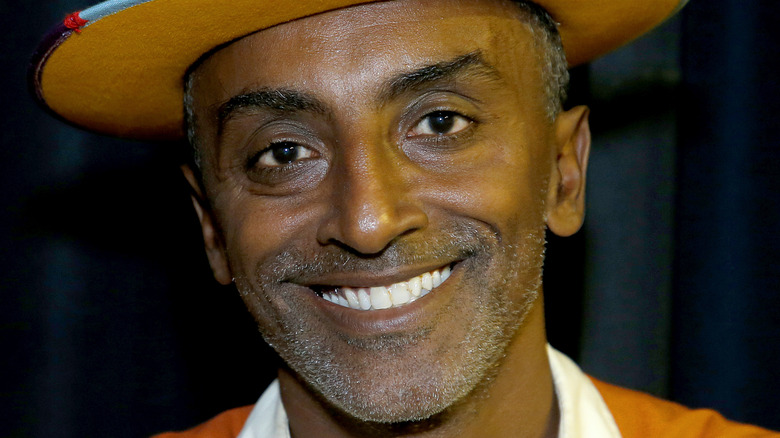 Marcus Samuelsson close-up in a hat