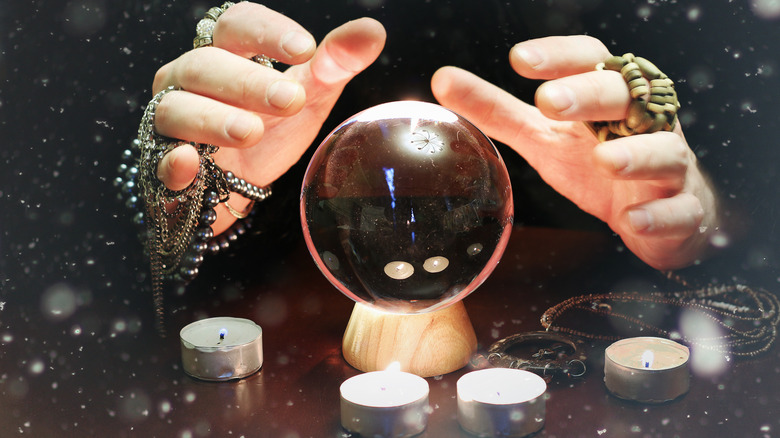 Hands over a crystal ball