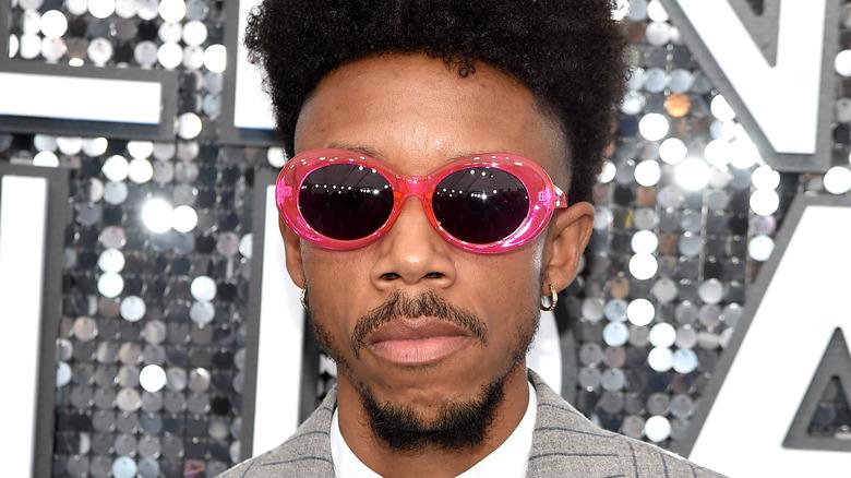 Darrell Britt-Gibson wearing pink sunglasses