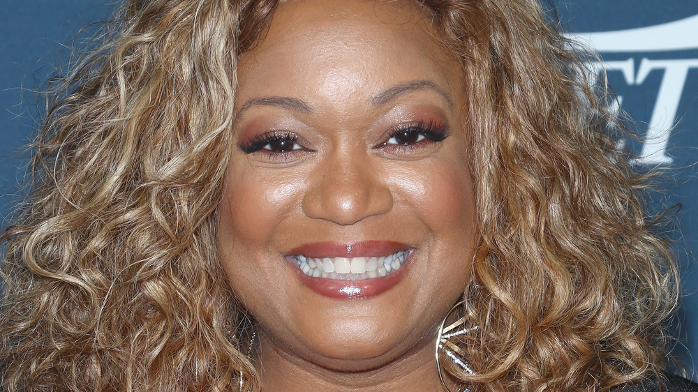 Sunny Anderson's head with earrings
