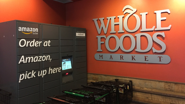 Amazon kiosk at Whole Foods store next to shopping carts