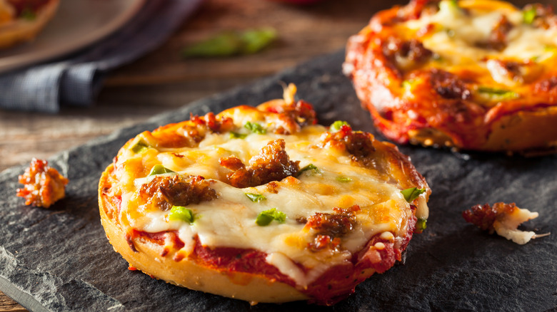 Pizza bagels sitting on a tray