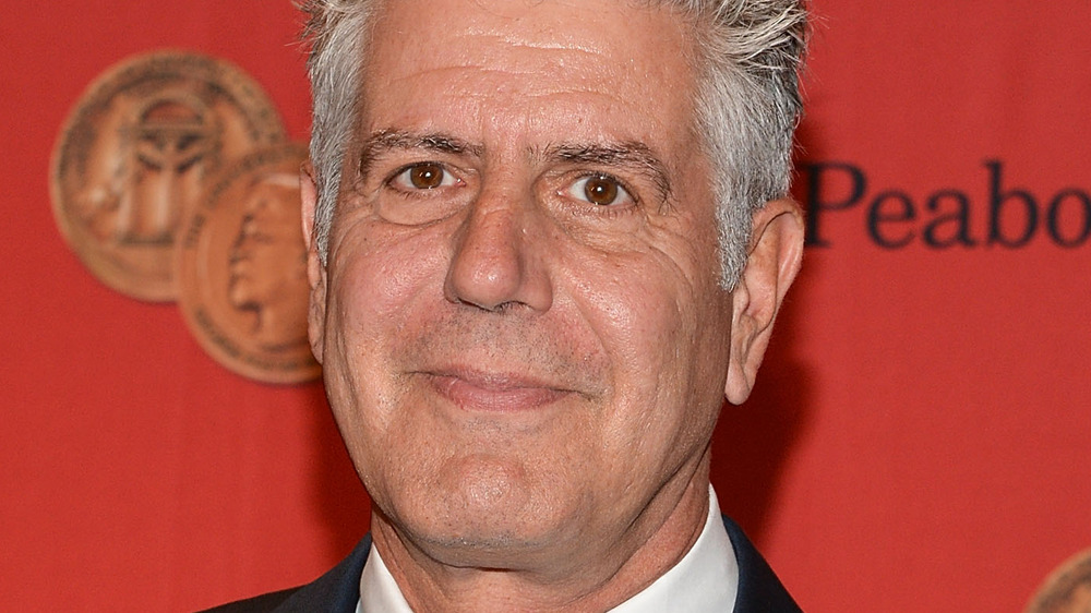 Anthony Bourdain against red background