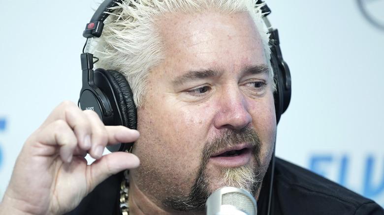 Guy Fieri wearing headphones