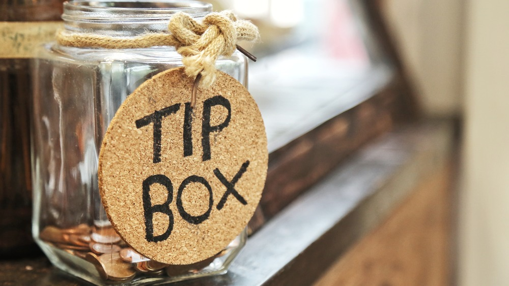 Tip jar with considerably less than $3000 contained within