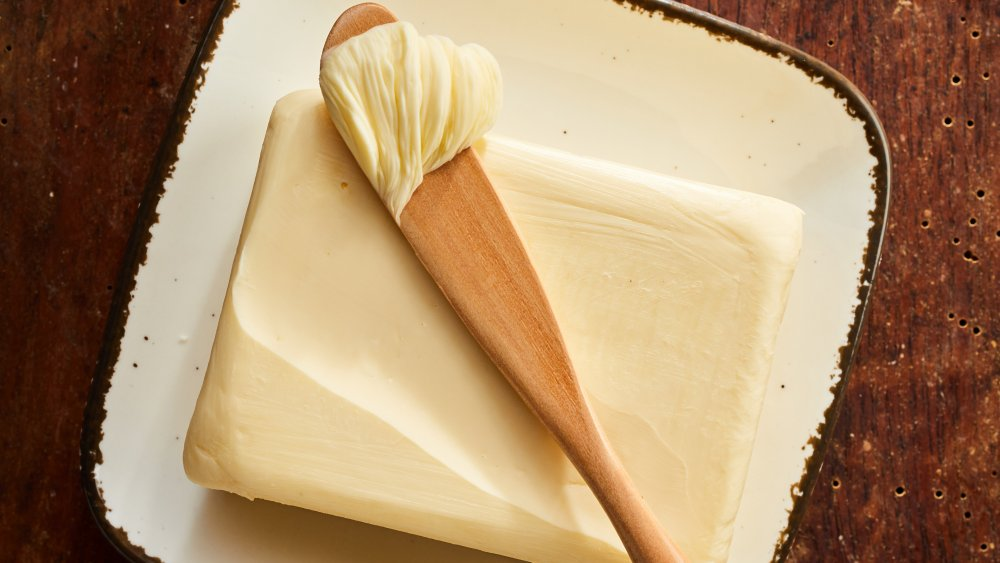 Butter on a wooden knife