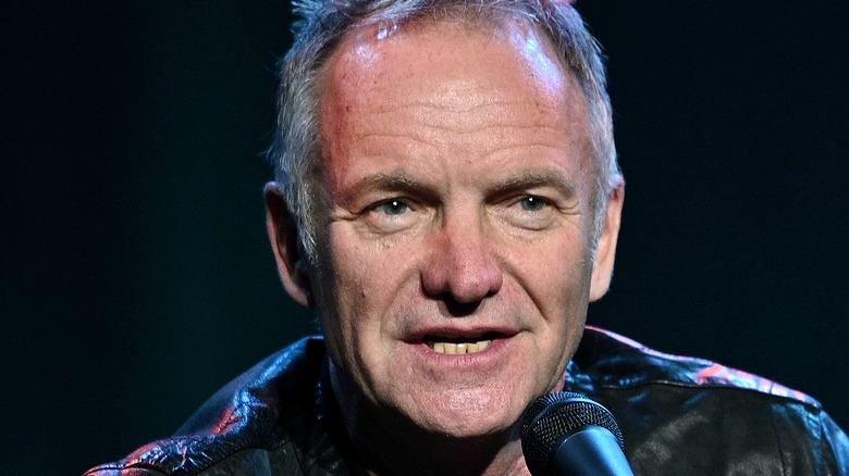 Sting talking into a microphone