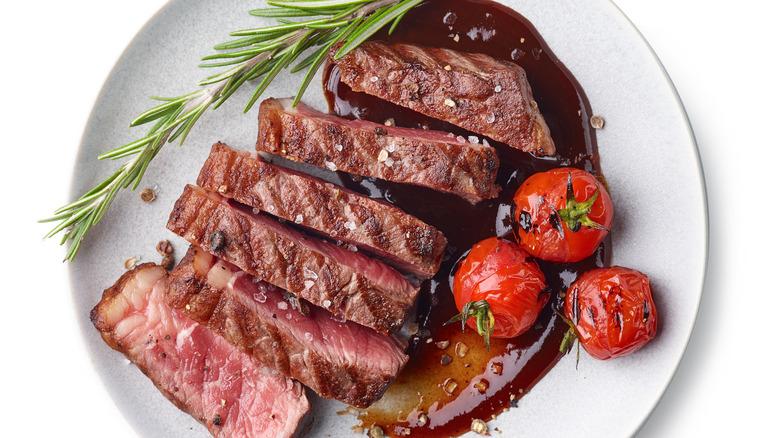 Sliced steak and roasted tomatoes