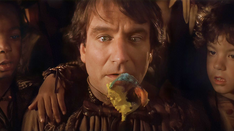 Robin Williams in movie Hook with colorful spoon