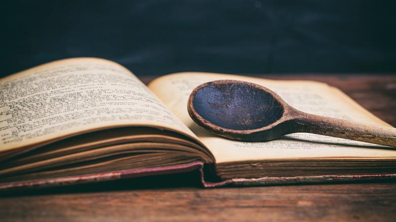 wooden ladle on cookbook