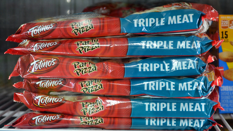 Stack of frozen Totino's Party Pizza in Triple Meat Flavor