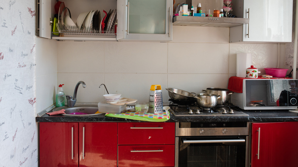 Home kitchen with cluttered counters