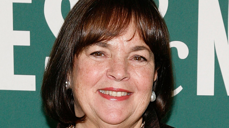 Ina Garten wearing red lipstick and smiling