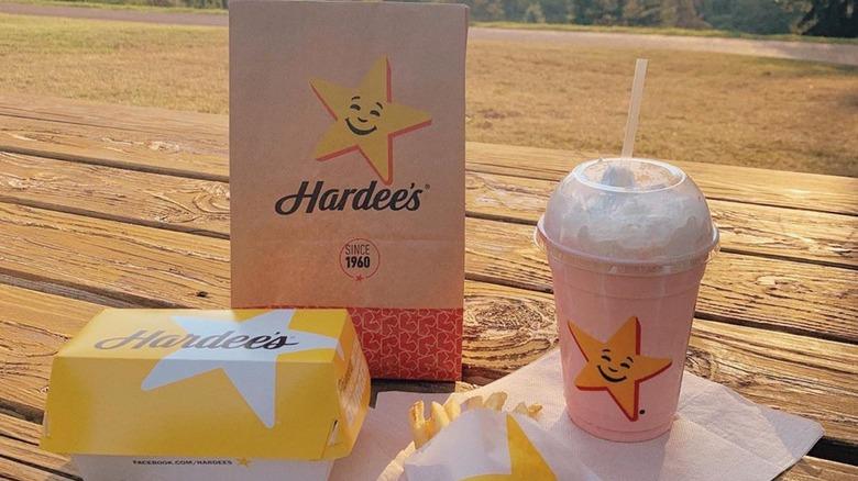 Hardee's to-go bag with milkshake and box