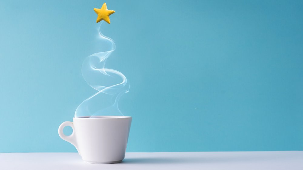 cup of coffee, steam in the shape of a tree, and a star