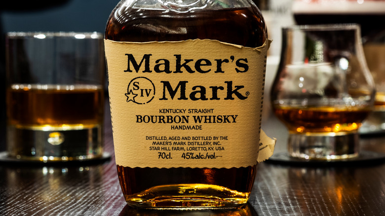 Maker's Mark bottle and glasses of whiskey