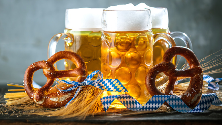 Steins of beer and pretzels