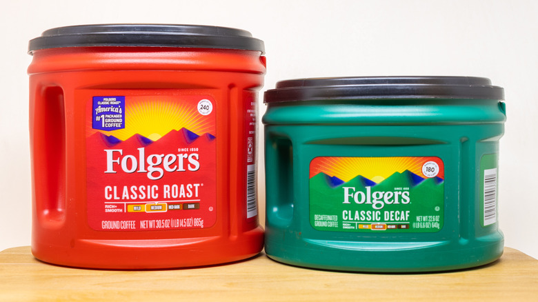Folger's coffee canisters on wood block