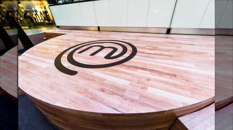 wooden table with MasterChef logo