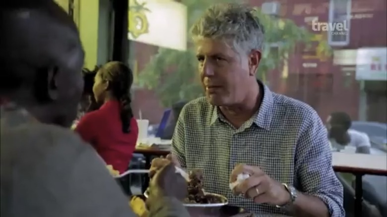 Anthony Bourdain and Michael K. Williams sitting at table