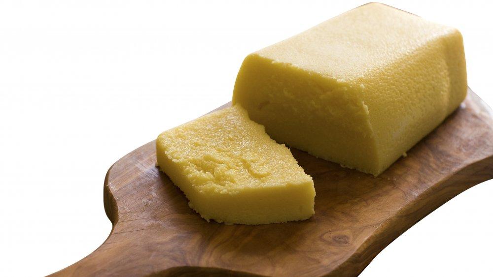 Cornmeal mush on a cutting board