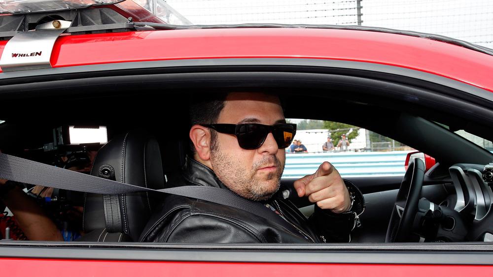Adam Richman sitting in car