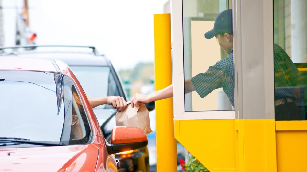 Person receiving takeout from drive thru