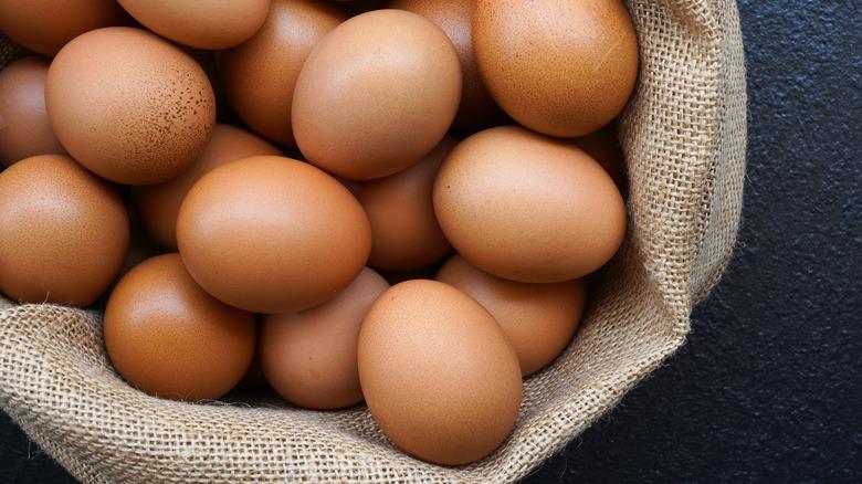 Brown eggs in burlap sack
