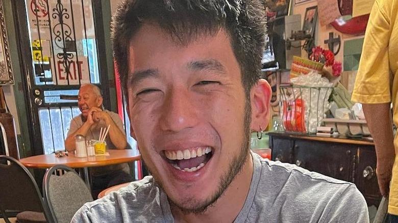 Shota Nakajima smiles in gray shirt