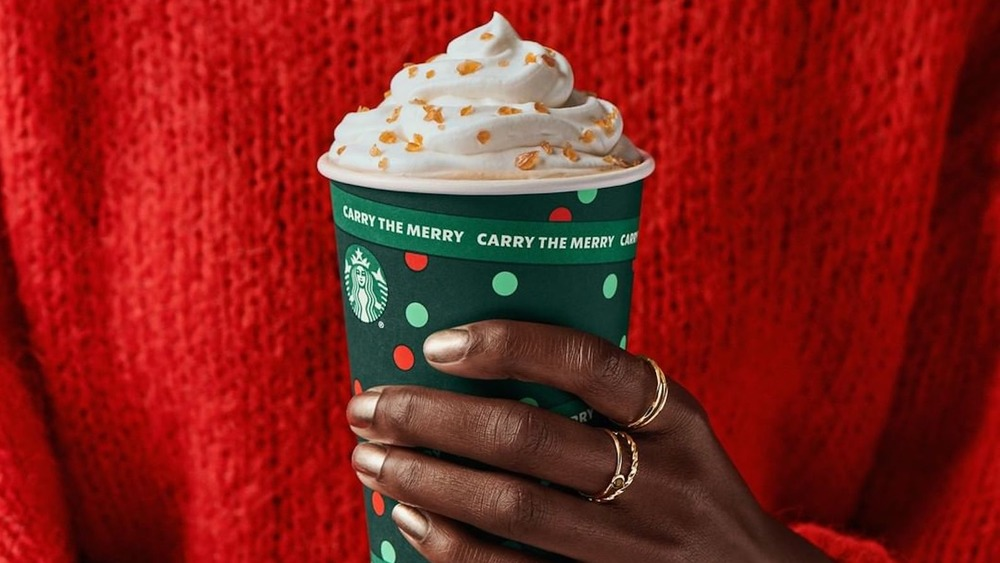 Starbucks Holiday drink in hand