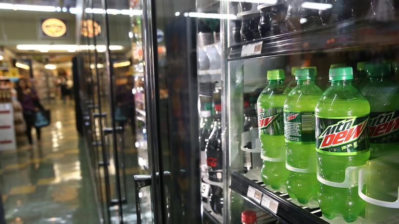 Bottles of Mountain Dew in a refrigerator