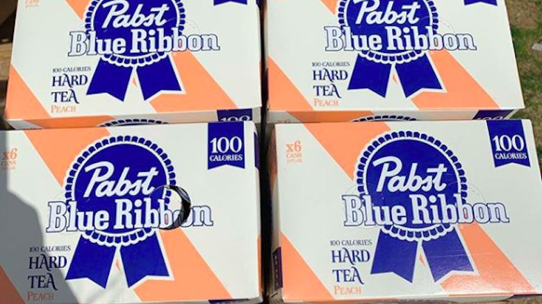 four cases of PBR Hard Tea Peach