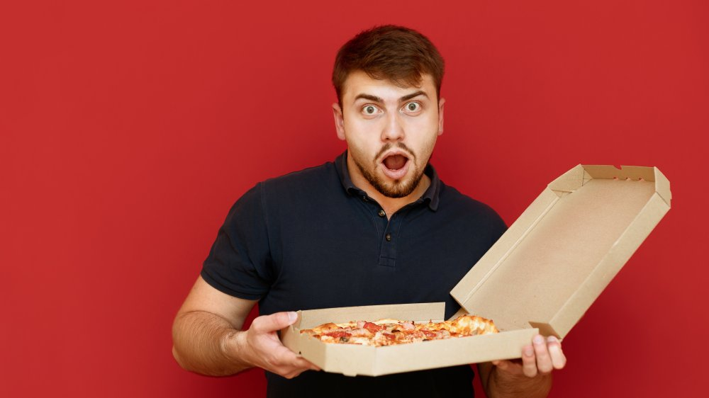surprised guy and pizza