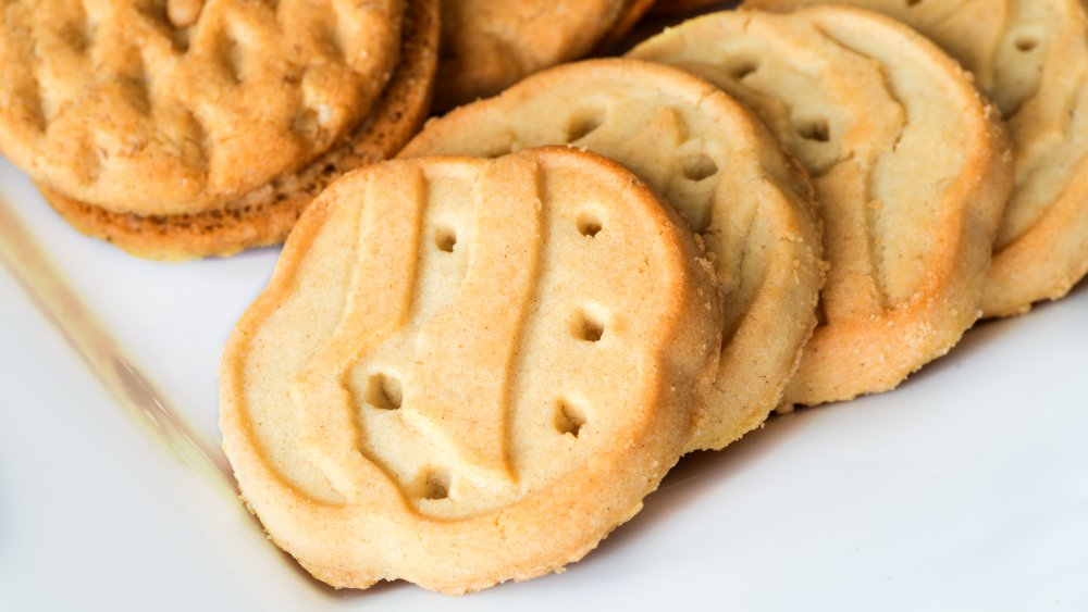 assorted girl scout cookies on white plate