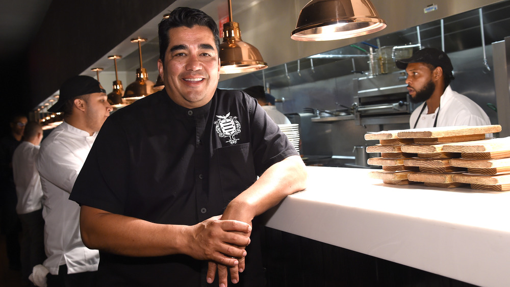 Jose Garces dressed in black