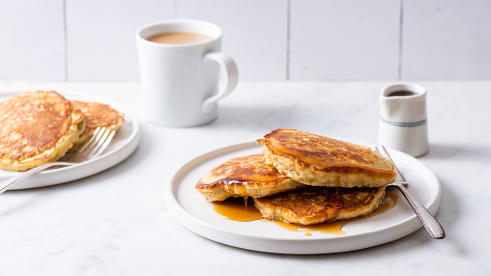 Oatmeal pancakes drizzled with maple syrup