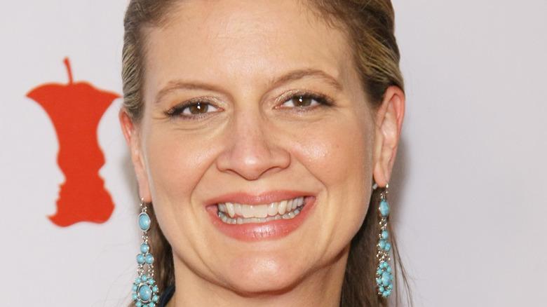 Amanda Freitag smiles with dangling earrings