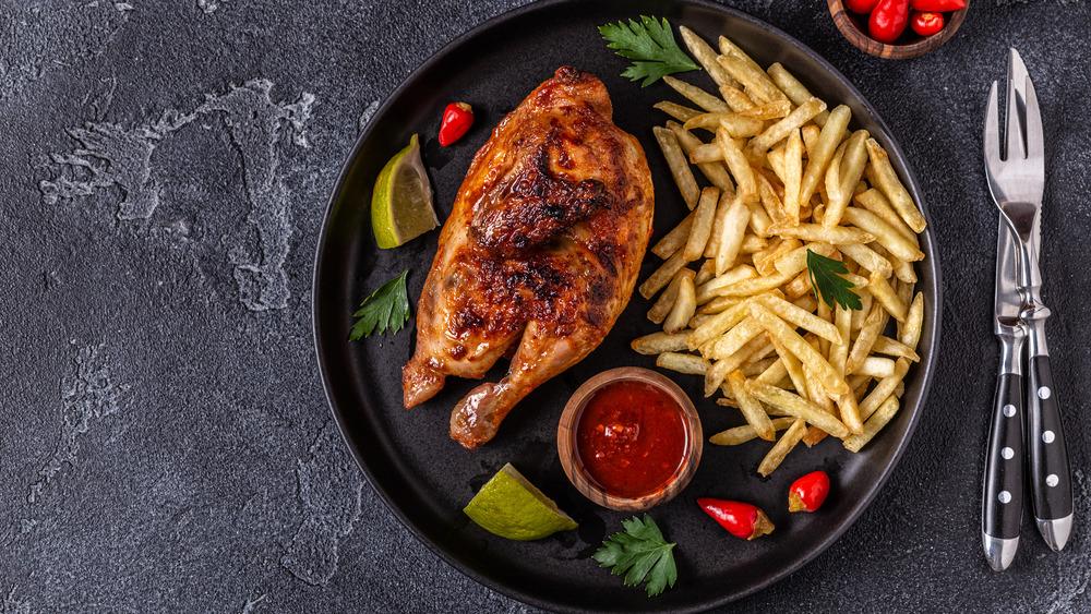 half roasted piri piri chicken on a plate