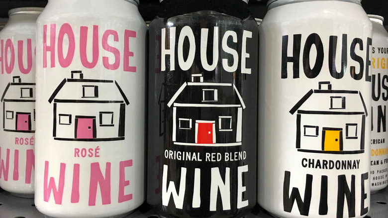 Row of colorful canned wines on store shelf