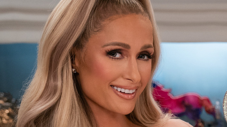 Paris Hilton in her kitchen wearing a That's Hot apron