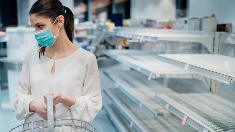 Shopper with empty shelves