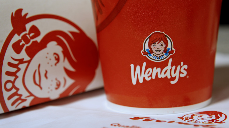 Wendy's cup and logo on menu