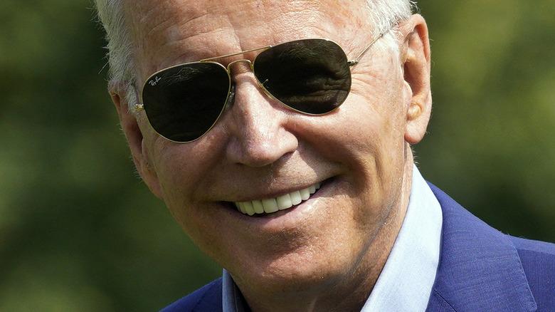 President Joe Biden wearing suit and sunglasses