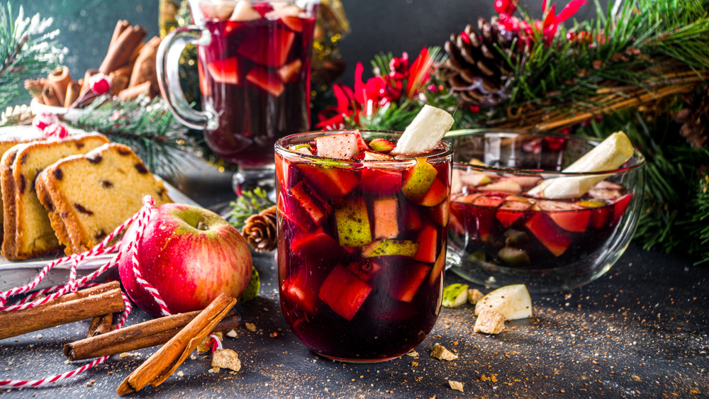 Christmas punch in glasses with ingredients