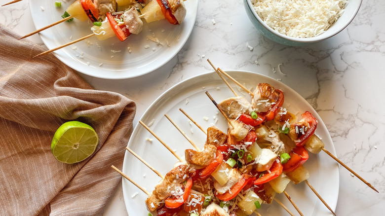 chicken skewers on a plate