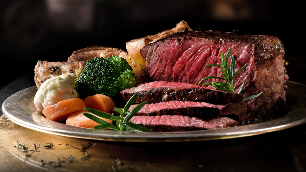 Rare roast beef with vegetables and Yorkshire pudding