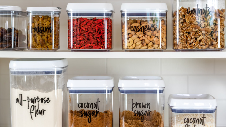 Pantry shelf filled with clear containers