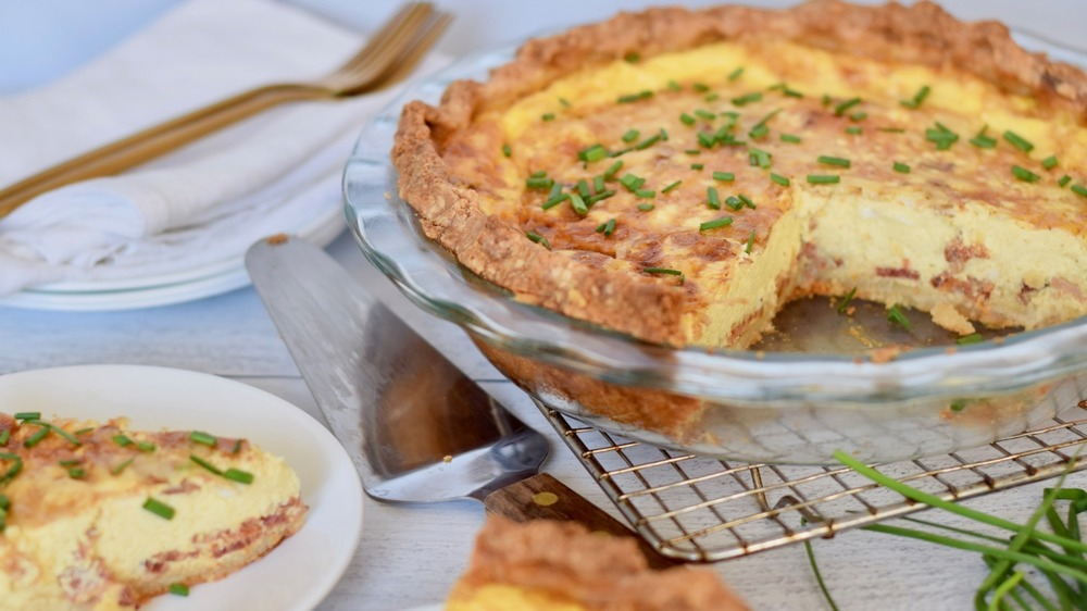 quiche lorraine with a slice taken out