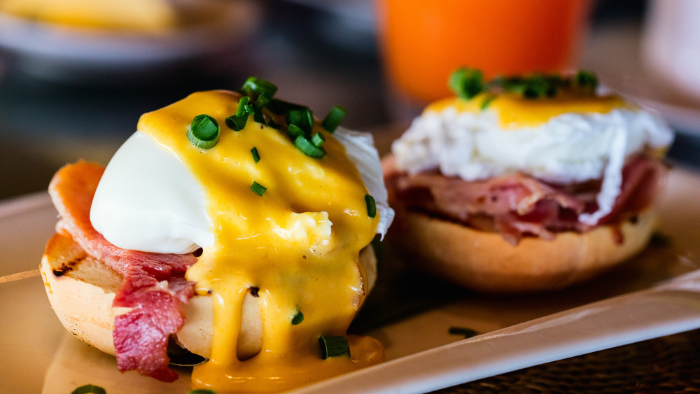 two poached egg bacon sandwiches