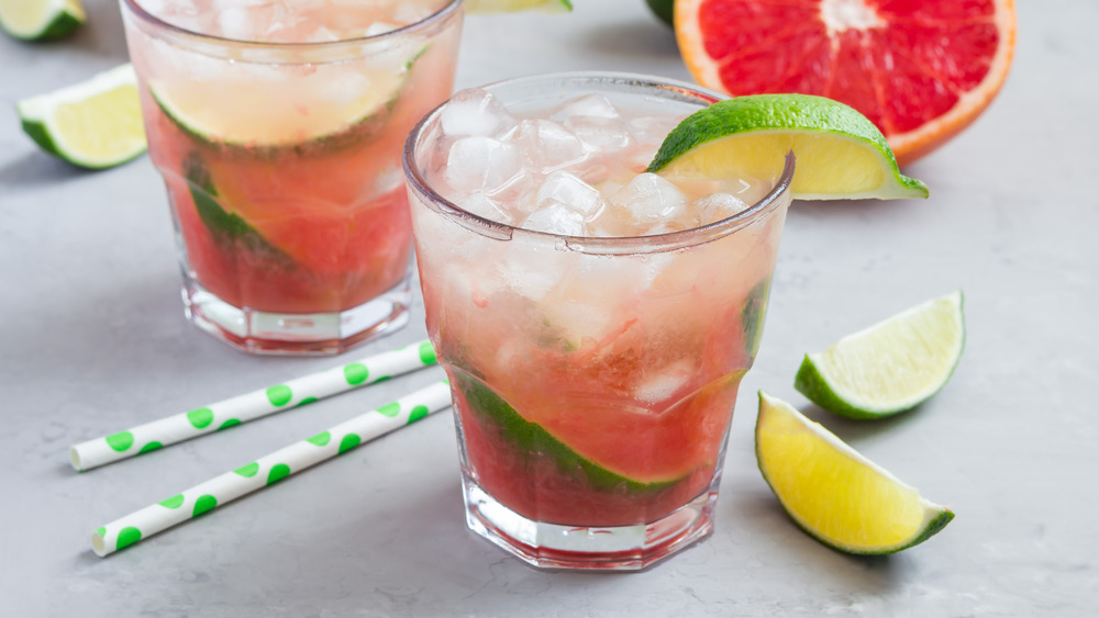 Two paloma cocktails with lime